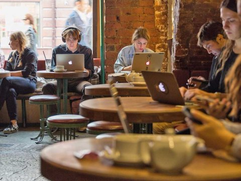 people-working-on-laptops-in-cafe